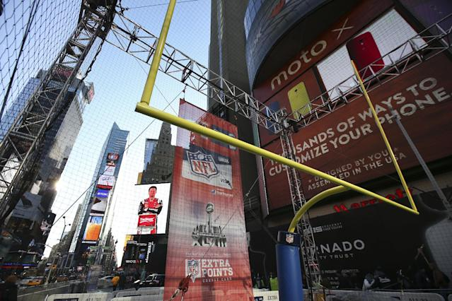 A field goal stands at an event space on Super Bowl Boulevard in Times Square before Indianapolis Colts placekicker Adam Vinatieri kicks a football to benefit NFL Play60 with a $10,000 donation from NFL Extra Points issued by Barclaycard, Wednesday, Jan. 29, 2014, in New York. (John Minchillo/AP Images for Barclaycard)