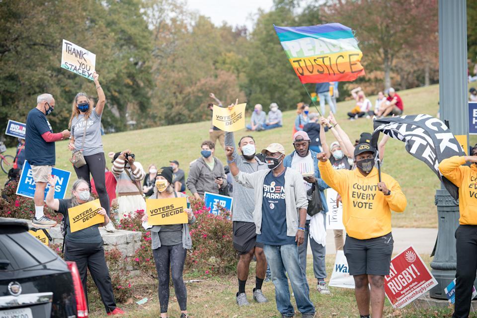"Rallygoers in Freedom Park deliver the ""Count Every Vote"" message in the wake of the presidential election results on November 7 in Atlanta. (Photo by Marcus Ingram/Getty Images for MoveOn)"