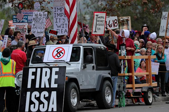Demonstrators protest against President Trump and Republican Rep. Darrell Issa outside Issa's office in Vista, Calif. (Photo: Mike Blake/Reuters)