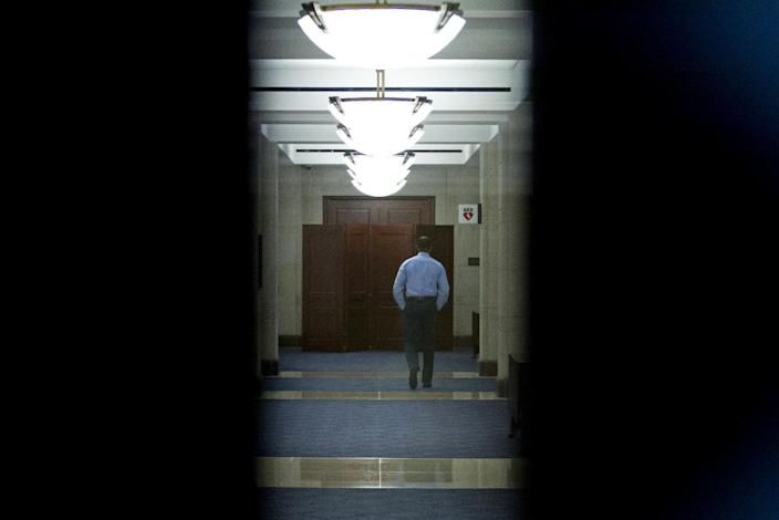 A folding room divider blocks a door down a corridor on Capitol Hill in Washington on Friday, Nov. 16, 2012, where the Senate Intelligence Committee is holding a hearing where former CIA Director David Petraeus is testifying on the Benghazi, Libya, terrorist attack against the U.S. consulate on the Sept. 11 attack in Libya. (AP Photo/Jose Luis Magana)