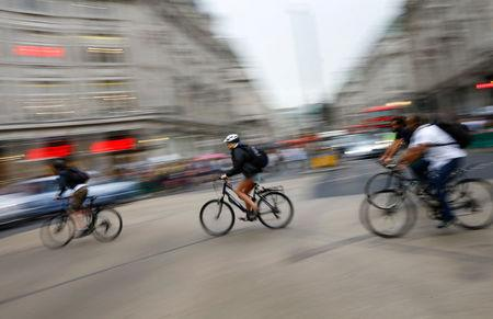 FILE PHOTO: Commuters cycle through Oxford Circus in London, Britain, August 5, 2015.   REUTERS/Darren Staples/File Photo