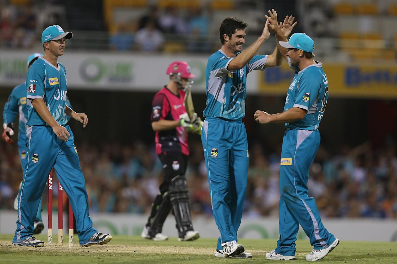 BRISBANE, AUSTRALIA - JANUARY 07:  Ben Cutting and Peter Forrest of the Heat celebrate dismissing Steven Smith of the Sixers during the Big Bash League match between the Brisbane Heat and the Sydney Sixers at The Gabba on January 7, 2013 in Brisbane, Australia.  (Photo by Chris Hyde/Getty Images)