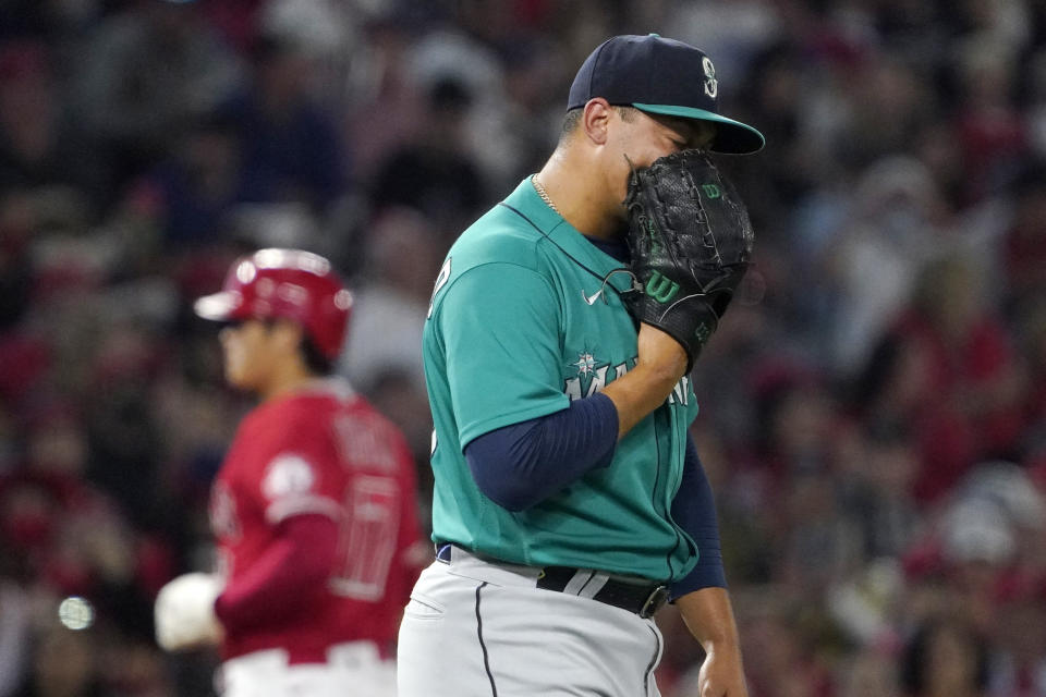 Seattle Mariners relief pitcher Justus Sheffield, right, yells into his glove after walking in a run as Los Angeles Angels designated hitter Shohei Ohtani advances to third during the fifth inning of a baseball game Saturday, Sept. 25, 2021, in Anaheim, Calif. (AP Photo/Mark J. Terrill)
