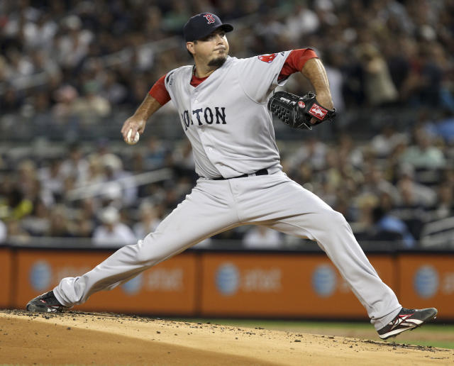 Boston Red Sox's Josh Beckett pitches during the first inning of the baseball game against the New York Yankees Sunday, Aug. 19, 2012 at Yankee Stadium in New York. (AP Photo/Seth Wenig)