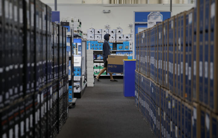 FILE - In this Nov. 26, 2019, file photo a man carries a television while shopping ahead of Black Friday at a Best Buy in Henderson, Nev. The nation's largest retail trade group said Thursday, Jan. 16, 2020, that holiday sales increased 4.1%, near the top end of its forecast. (AP Photo/John Locher, File)