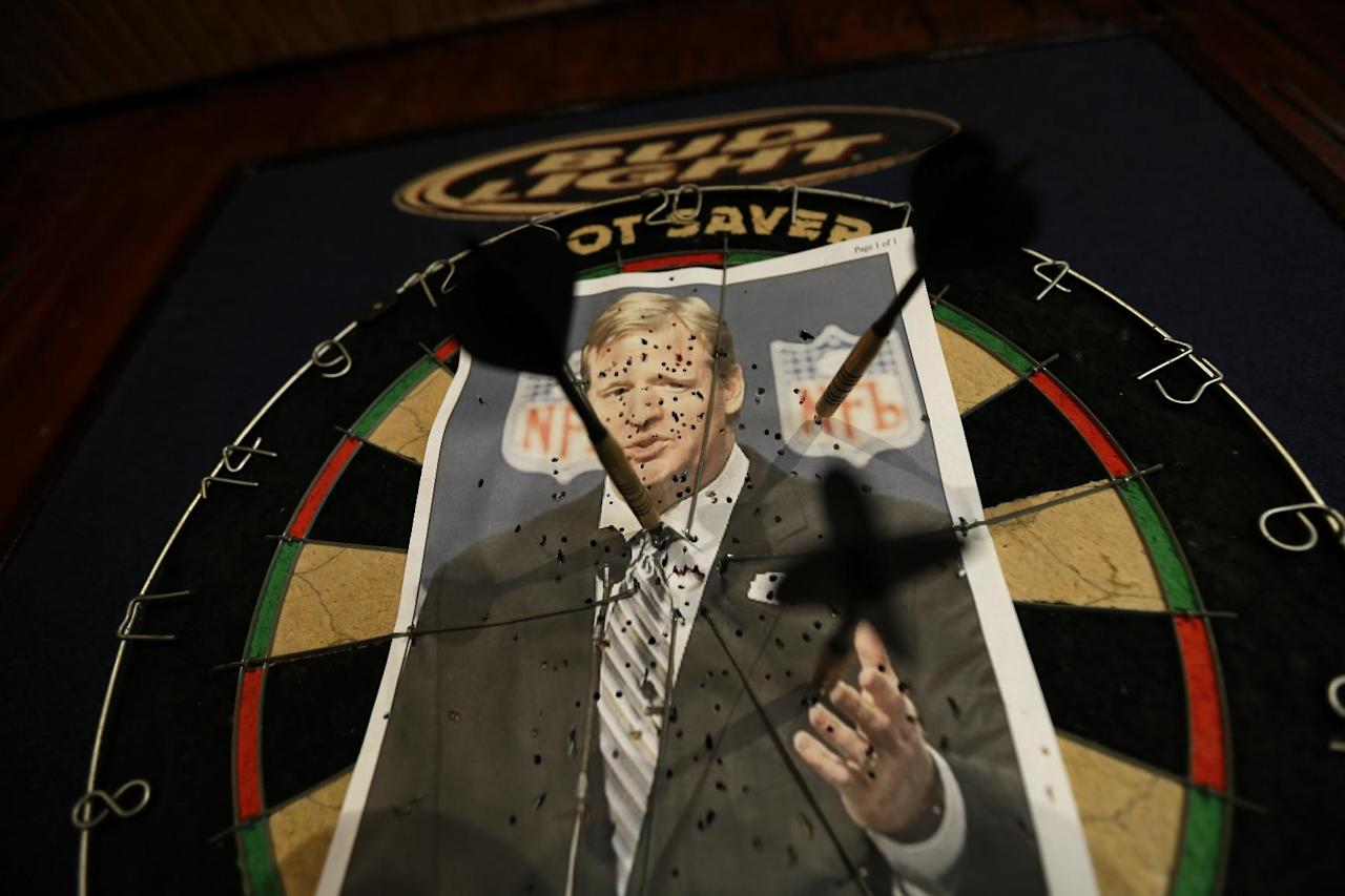 "A photo of NFL commissioner Roger Goodell is seen on a dartboard inside the Parkview Tavern in New Orleans, Friday, Jan. 25, 2013. New Orleans is celebrating the return of New Orleans Saints coach Sean Payton after a season's NFL banishment as a result of the ""Bountygate"" scandal. But the good feeling does not extend to Goodell, who suspended Payton and other key players and coaches last year in the alleged pay-for-pain scheme. He is being ridiculed here with a vehemence usually reserved for the city's multitude of scandal-scarred politicians. (AP Photo/Gerald Herbert)"