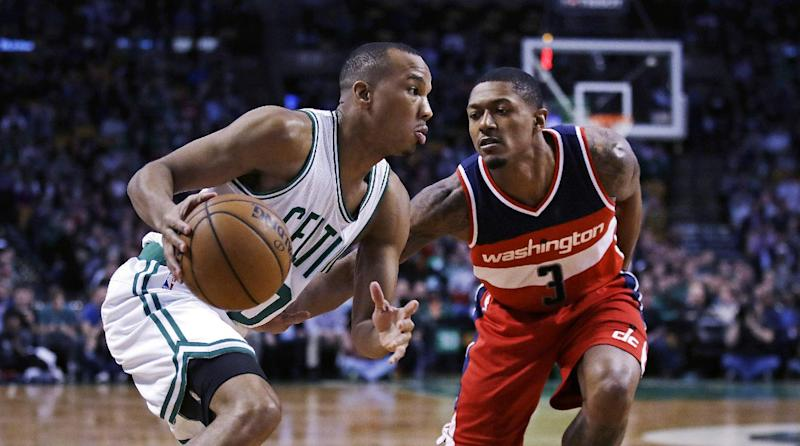 Boston Celtics guard Avery Bradley, left, sets to drive to the basket against Washington Wizards guard Bradley Beal (3) during the first quarter of a basketball game in Boston, Monday, March 20, 2017. (AP Photo/Charles Krupa)