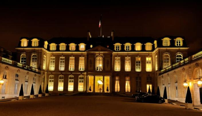 FILE PHOTO: Elysee Palace is illuminated before the press conference of French President Emmanuel Macron in Paris
