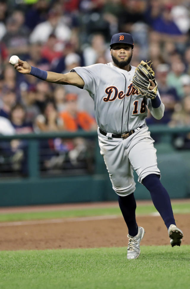 Detroit Tigers' Dawel Lugo throws to first base but not in time to get Cleveland Indians' Francisco Lindor in the third inning in a baseball game Thursday, Sept. 19, 2019, in Cleveland. (AP Photo/Tony Dejak)