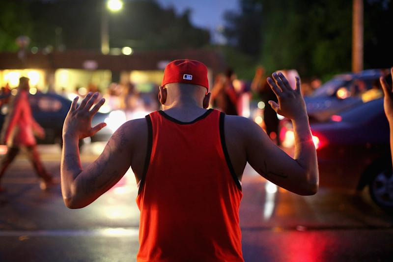 Demonstrators gather along West Florissant Avenue in Ferguson on Aug. 15, 2014. (Scott Olson via Getty Images)