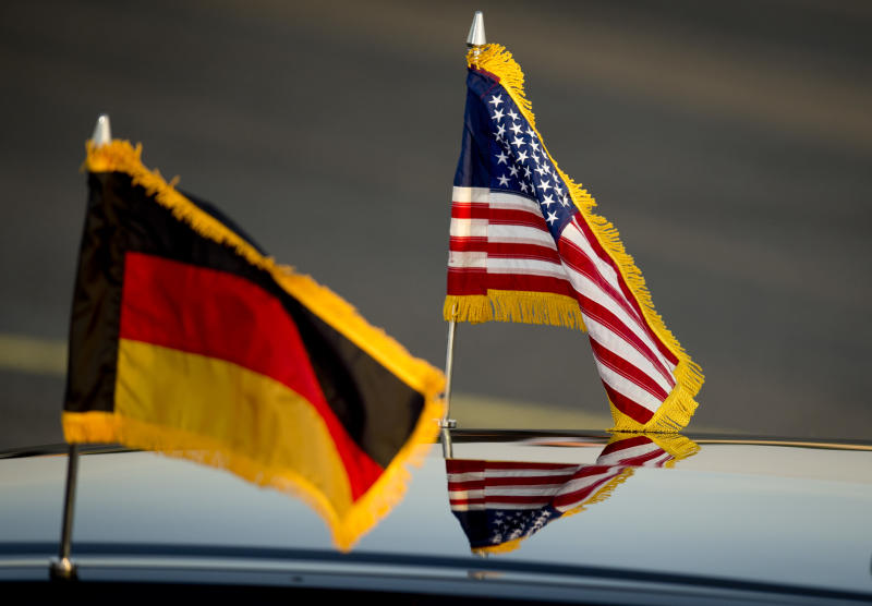 US (R) and a German flags are seen on a car on the arrival of US President Obama at Berlin Tegel airport on June 18, 2013