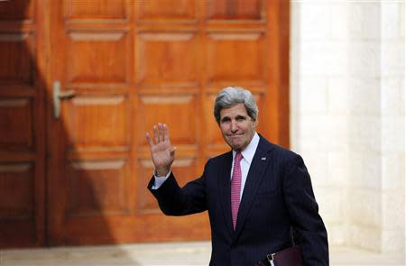 U.S. Secretary of State Kerry waves upon arrival for a meeting with Palestinian President Abbas in Ramallah