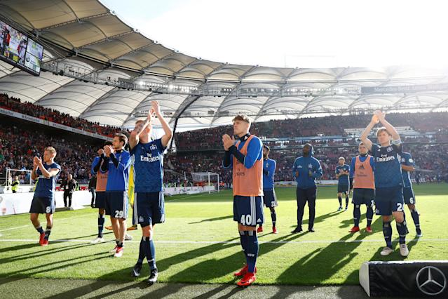 Soccer Football - Bundesliga - VfB Stuttgart vs Hamburger SV - Mercedes-Benz Arena, Stuttgart, Germany - March 31, 2018 Hamburg's Rick van Drongelen, Gotoku Sakai and team mates applaud the fans at the end of the match REUTERS/Kai Pfaffenbach DFL RULES TO LIMIT THE ONLINE USAGE DURING MATCH TIME TO 15 PICTURES PER GAME. IMAGE SEQUENCES TO SIMULATE VIDEO IS NOT ALLOWED AT ANY TIME. FOR FURTHER QUERIES PLEASE CONTACT DFL DIRECTLY AT + 49 69 650050