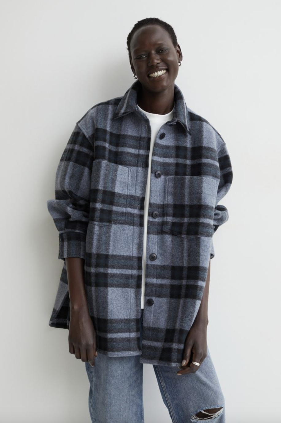 black model with short hair wearing blue plaid Felted Shirt Jacket and blue jeans