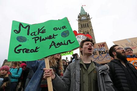 Students hold a protest against climate change on Parliament Hill in Ottawa, Ontario, Canada, March 15, 2019. REUTERS/Chris Wattie