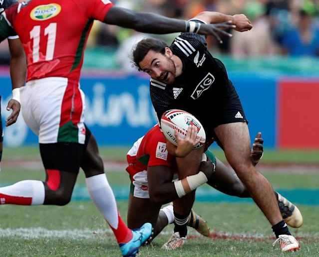 Rugby Union - Kenya v New Zealand - World Rugby Sevens Series - Hong Kong Stadium, Hong Kong, China - April 8, 2018 - New Zealand's Jordan Bunce is tackled. REUTERS/Bobby Yip