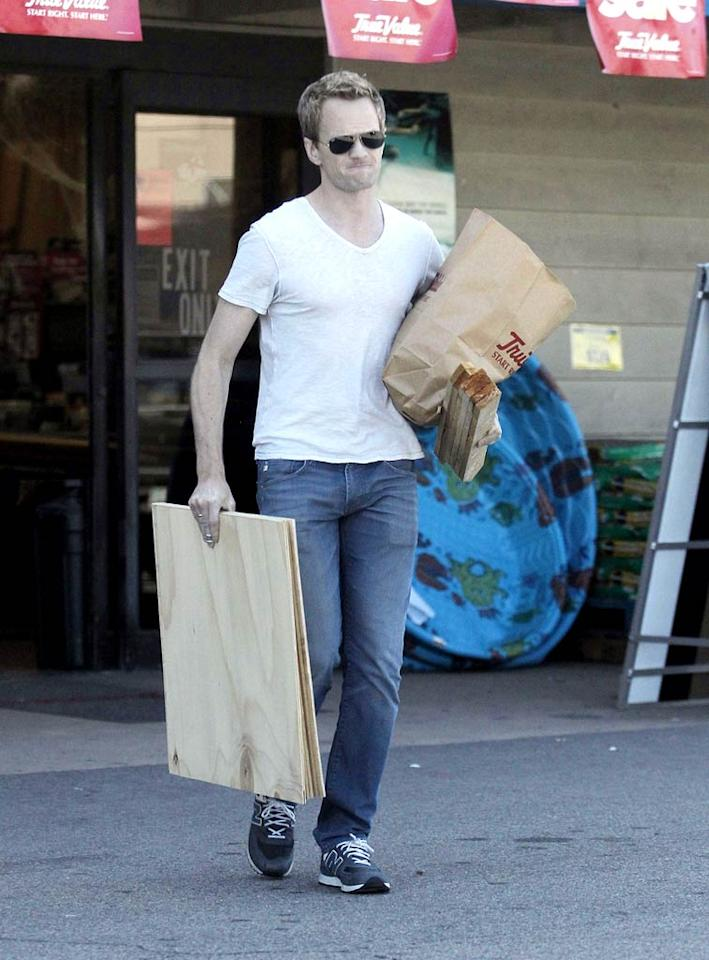 Though Neil Patrick Harris is engaged to partner David Burtkas (with whom he has 1-year-old twins), he made the shopping trip solo, which meant he had to lug his lumber out to the car all by himself! (10/28/2011)