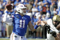 Florida quarterback Kyle Trask (11) throws a pass as he is pressured by Vanderbilt defensive lineman Rutger Reitmaier, right, during the first half of an NCAA college football game, Saturday, Nov. 9, 2019, in Gainesville, Fla. (AP Photo/John Raoux)