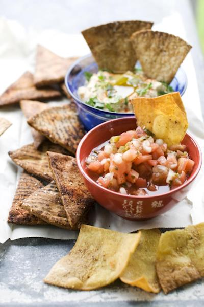 In this image taken on June 10, 2013, baked whole wheat pita chips, left, baked whole wheat tortilla chips, top right, and fried tortilla chips with cinnamon sugar are shown in Concord, N.H. (AP Photo/Matthew Mead)