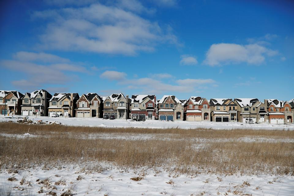 A row of houses stand in a subdivision in East Gwillimbury, Ontario, Canada (REUTERS)