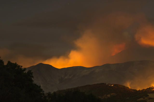 <p>The Whittier Fire burns through the night on July 9, 2017 near Santa Barbara, California. (David McNew/Getty Images) </p>