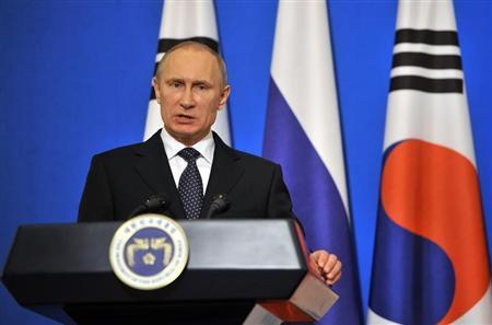 Russian President Vladimir Putin speaks during a news conference in Seoul