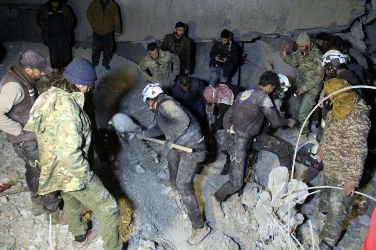 Syrian civil defence volunteers, known as the White Helmets, dig through the rubble of a mosque following a US air strike on the village of Al-Jineh late on March 16, 2017