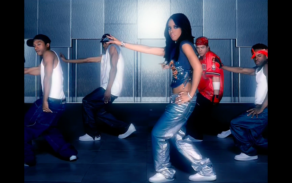 """<cite class=""""credit"""">Screenshot/Youtube. """"We Need A Resolution"""" music video, Aaliyah.</cite>"""