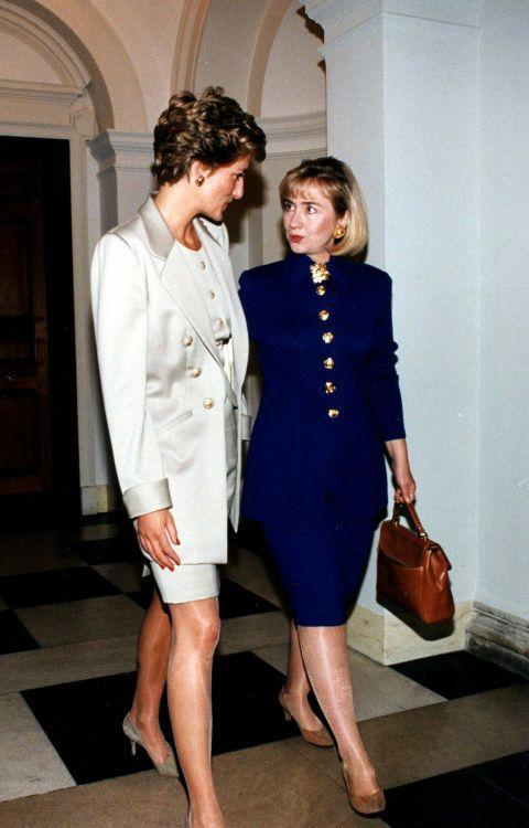 <p>Power suit, check! Big gold buttons, check! Princess Di and Hillary Clinton share a style moment during a luncheon at the British Embassy in 1994.</p>