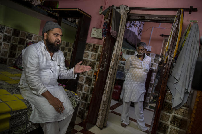 Haroon, who saw his 32 year-old brother being shot and killed by his Hindu neighbors during the February 2020 communal riots, speaks to the Associated Press inside his home in North Ghonda, one of the worst riot affected neighborhood, in New Delhi, India, Friday, Feb. 19, 2021. As the first anniversary of bloody communal riots that convulsed the Indian capital approaches, Muslim victims are still shaken and struggling to make sense of their struggle to seek justice. (AP Photo/Altaf Qadri)