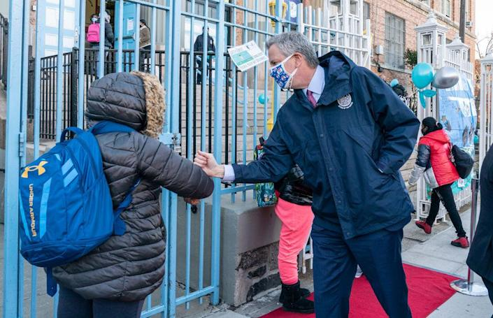 Mayor Bill de Blasio greets students during visit of Bronx Leaders of Tomorrow Richard R. Green Middle School on reopening day in February. (Radin/Pacific Press/LightRocket / Getty Image)