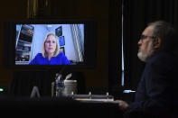 Sen. Kirsten Gillibrand, D-N.Y., speaks virtually during a Senate Environment and Public Works Committee oversight hearing to examine the Environmental Protection Agency, Wednesday, May 20, 2020 on Capitol Hill in Washington, with Andrew Wheeler, administrator of the Environmental Protection Agency, left. (Kevin Dietsch/Pool via AP)