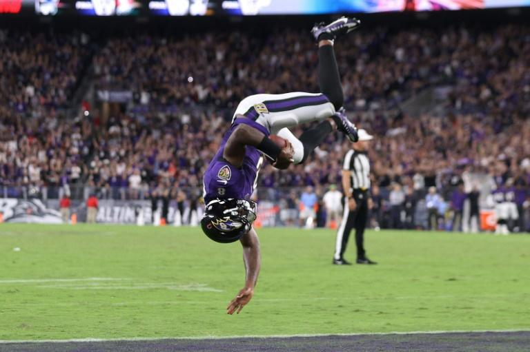 Baltimore Ravens quarterback Lamar Jackson flips into the endzone for a touchdown against the Kansas City Chiefs during the fourth quarter at M&T Bank Stadium (AFP/Rob Carr)