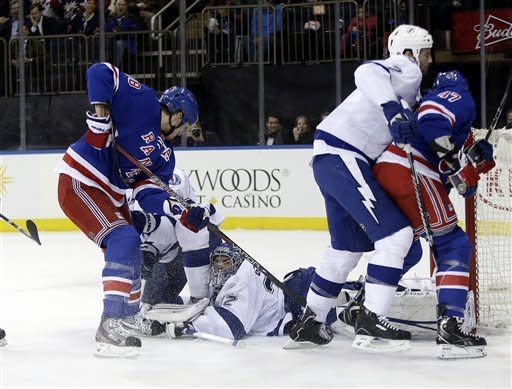 Tampa Bay Lightning goalie Mathieu Garon attempts to stop New York Rangers' Marc Staal (18) from scoring during the second period of an NHL hockey game on Thursday, Feb. 28, 2013, in New York. Staal scored on the play. (AP Photo/Frank Franklin II)