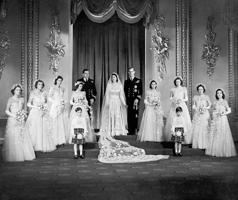 The couple with Elizabeth's eight bridesmaids in the throne room at Buckingham Palace, including her sister, Princess Margaret, to the right of Philip.
