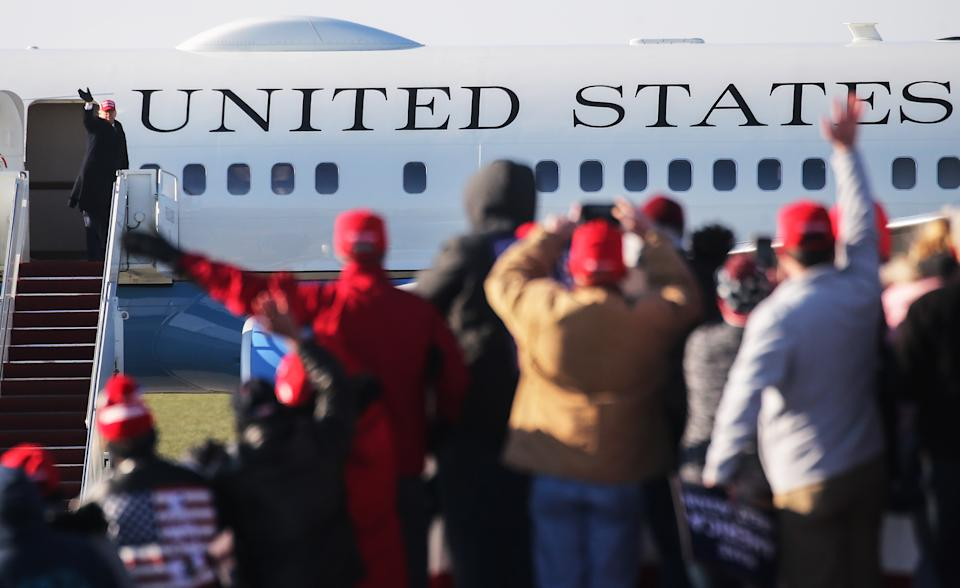 President Trump disembarks Air Force 1 to a sea of supporters.