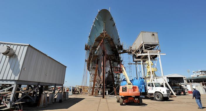 Workers with Ingalls Shipbuilding work on a U.S. Coast Guard project at the shipyard in Pascagoula, Miss.