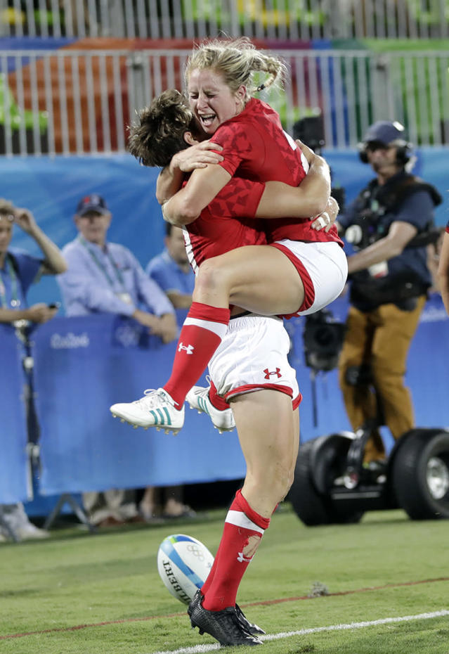 <p>Canada's Kayla Moleschi, right, celebrates with teammate Ghislaine Landry, for scoring the winning try during the women's rugby sevens quarter final match against France at the Summer Olympics in Rio de Janeiro, Brazil, Sunday, Aug. 7, 2016. (AP Photo/Themba Hadebe) </p>