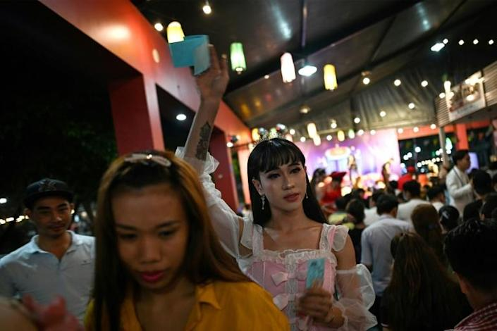 Lotto shows used to be a regular part of rural life in Vietnam's south but their appeal began to fade until Sai Gon Tan Thoi burst onto the mainstream nightlife circuit in 2017 (AFP Photo/Manan VATSYAYANA)