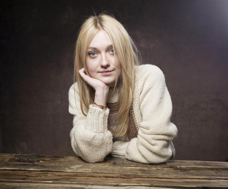 "Dakota Fanning from the film ""Very Good Girls"" poses for a portrait during the 2013 Sundance Film Festival at the Fender Music Lodge, on Tuesday Jan. 22, 2013 in Park City, Utah. (Photo by Victoria Will/Invision/AP Images)"