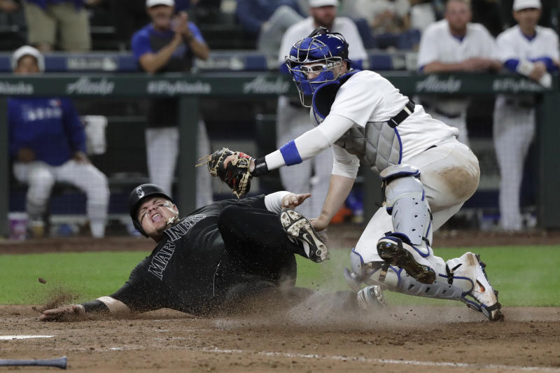 Seattle Mariners' Daniel Vogelbach, left, is tagged out by Toronto Blue Jays catcher Danny Jansen as he tried to score on a ball hit y Tom Murphy during the eighth inning of a baseball game Saturday, Aug. 24, 2019, in Seattle. (AP Photo/Ted S. Warren)
