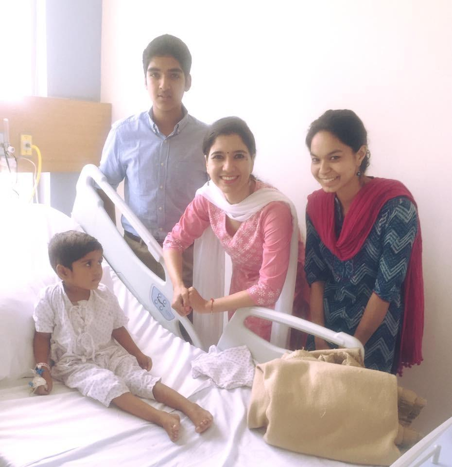 Visiting Krishna, a child supported by Genesis Foundation.