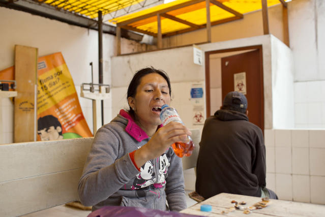 <p>Tamara takes her daily dosage of tuberculosis medication at a nearby clinic. Though TB drugs are free in Peru, patients are not allowed to take their medication at home, so people have to go to the clinic every day, which can be tiresome and taxing for physically weak patients like Tamara. (Photo: Danielle Villasana) </p>