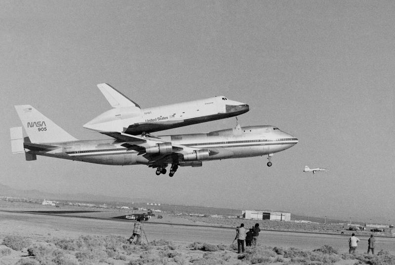 FILE - In this Feb. 18, 1977 file photo, America's Space Shuttle Enterprise, rides atop a giant 747 on its first test flight at Edwards Air Force Base, Calif. Enterprise is scheduled to arrive in New York on the back of a NASA jumbo jet on Friday, April 27, 2012, where it will be stored in an hangar at John F. Kennedy International Airport before assuming its new permanent location on the deck of the Intrepid Air and Space Museum in New York Harbor. (AP Photo)