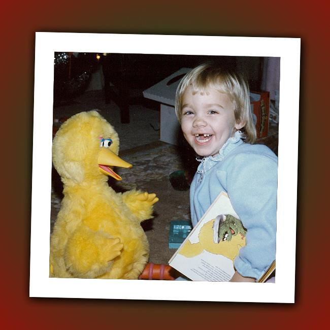 Why is this girl laughing? Maybe Big Bird is telling her she'll grow up to play an alien on a hit ABC drama. Can you guess who?
