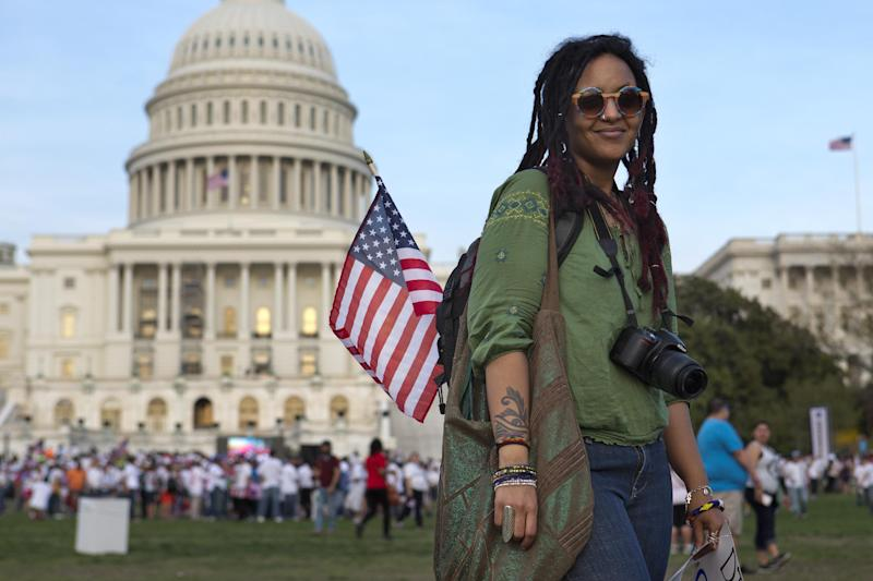 "ADDS TO CLARIFY SUBJECTS BACKGROUND - Ajna, 28, of Washington, an artist who goes by only her first name and is of Ethiopian and Eritrean descent, poses for a portrait at the end of the ""Rally for Citizenship"" on Capitol Hill in Washington on Wednesday, April 10, 2013. (AP Photo/Jacquelyn Martin)(AP Photo/Jacquelyn Martin)"