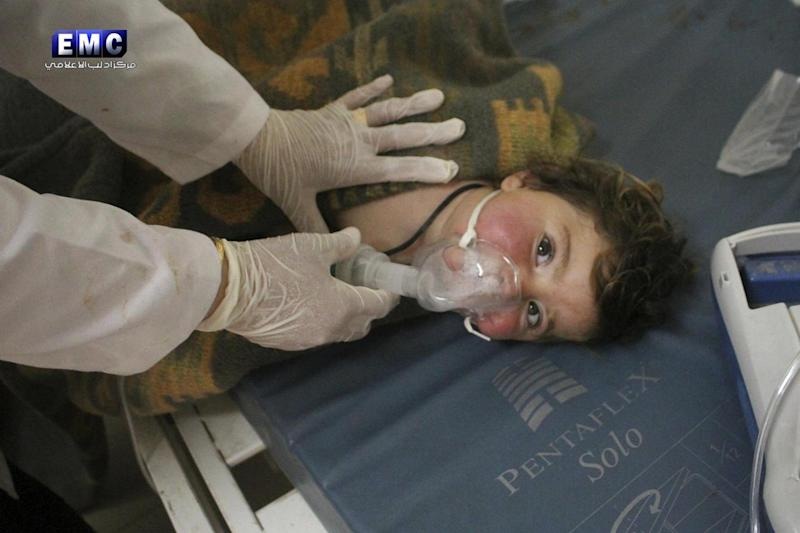 Hospital: A Syrian doctor treats a child following a suspected chemical attack at a makeshift medical centre (AP)