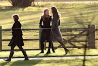 <p>For her first official Christmas as a royal, Kate wore an olive green knee-length coat from Reiss.</p>