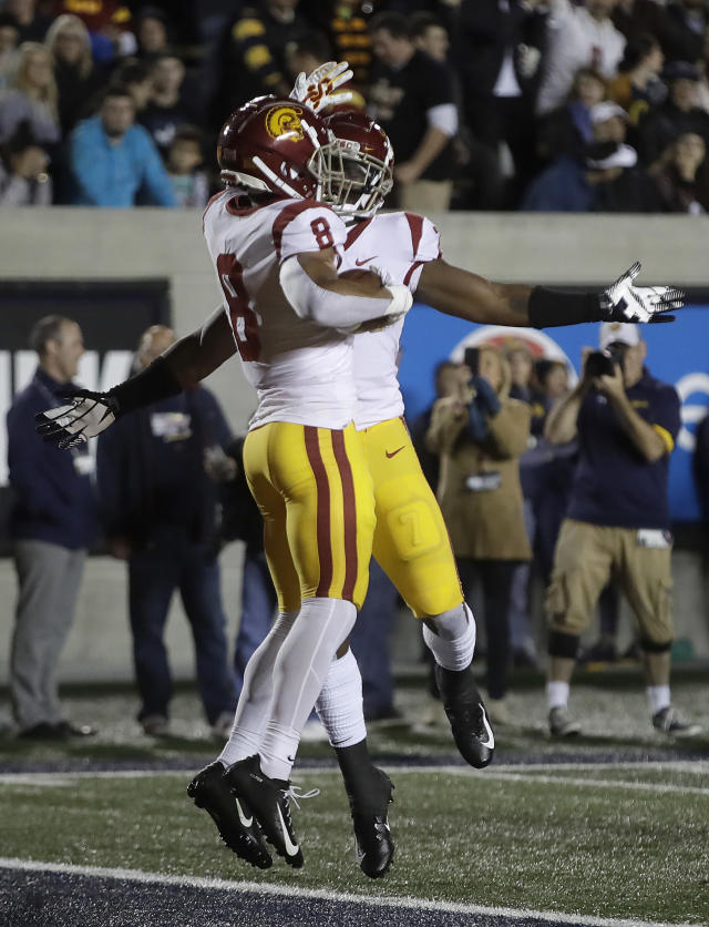 Southern California's Amon-Ra St. Brown (8) celebrates with Stephen Carr, right, after scoring a touchdown against California during the first quarter of an NCAA college football game Saturday, Nov. 16, 2019, in Berkeley, Calif. (AP Photo/Ben Margot)