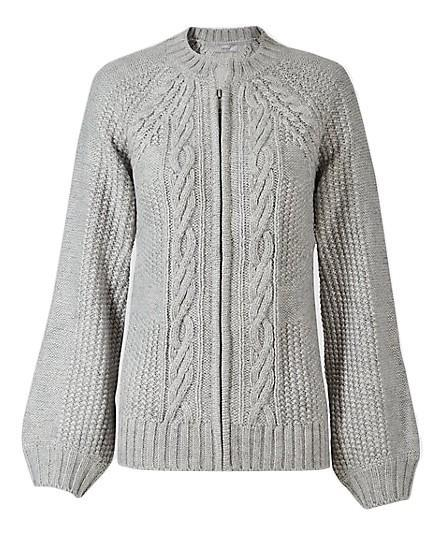 """<p>Marks and Spencer has seriously upped its sartorial game over the past couple of years. Need proof? Look no further than their knit department. <em><a rel=""""nofollow noopener"""" href=""""http://www.marksandspencer.com/cable-knit-round-neck-cardigan/p/p22511711?image=SD_01_T38_8014U_KU_X_EC_90&color=SILVERGREY&prevPage=plp"""" target=""""_blank"""" data-ylk=""""slk:Marks and Spencer"""" class=""""link rapid-noclick-resp"""">Marks and Spencer</a>, £39.50</em> </p>"""